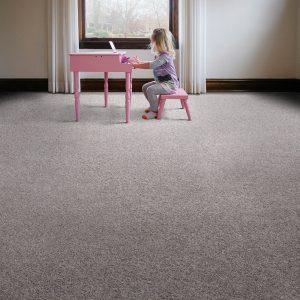 Girl playing piono on carpet flooring | Shoreline Flooring