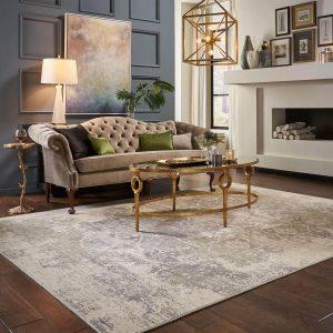 Coffee table on area rug | Shoreline Flooring