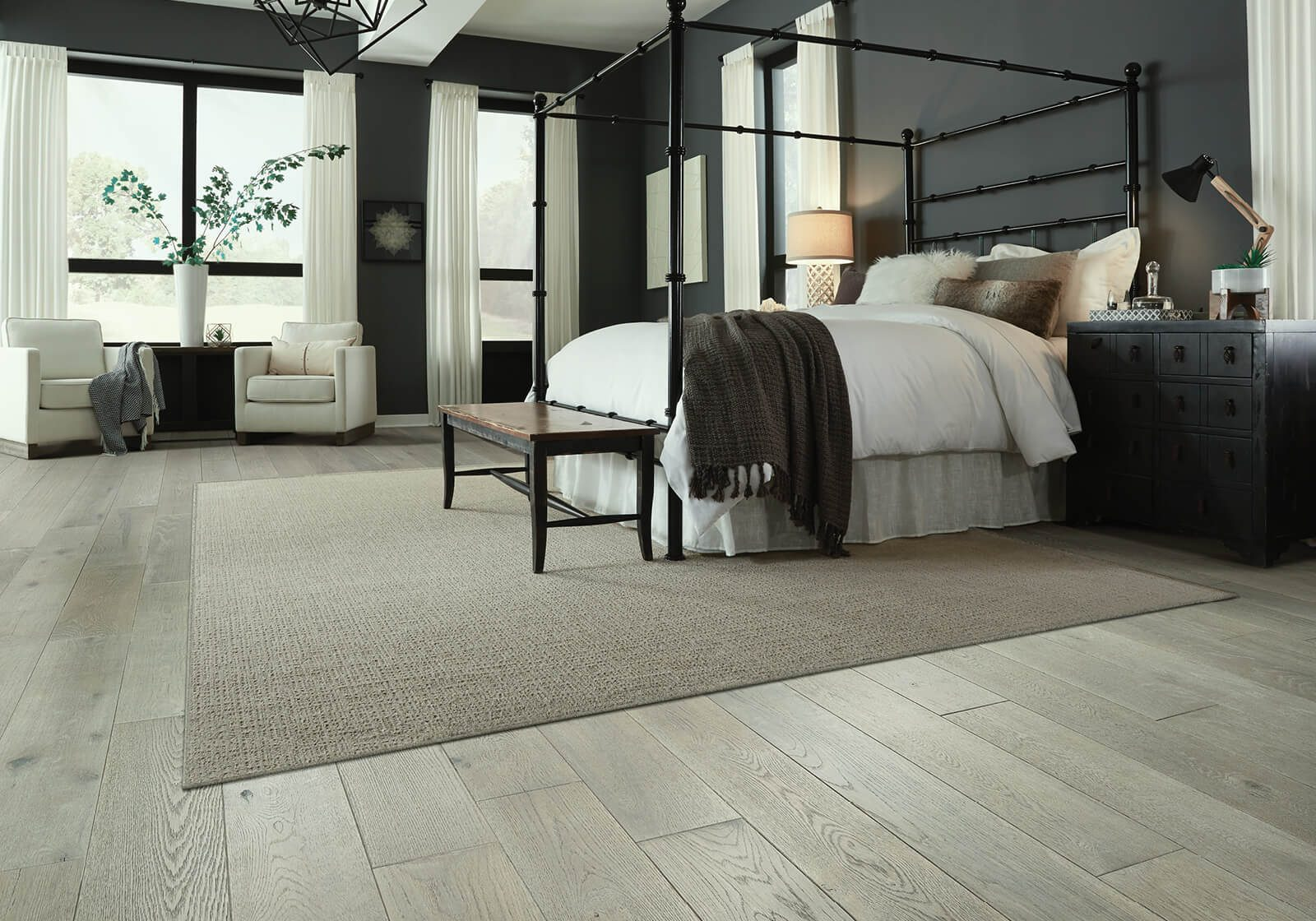 custom area rug in bedroom | Shoreline Flooring
